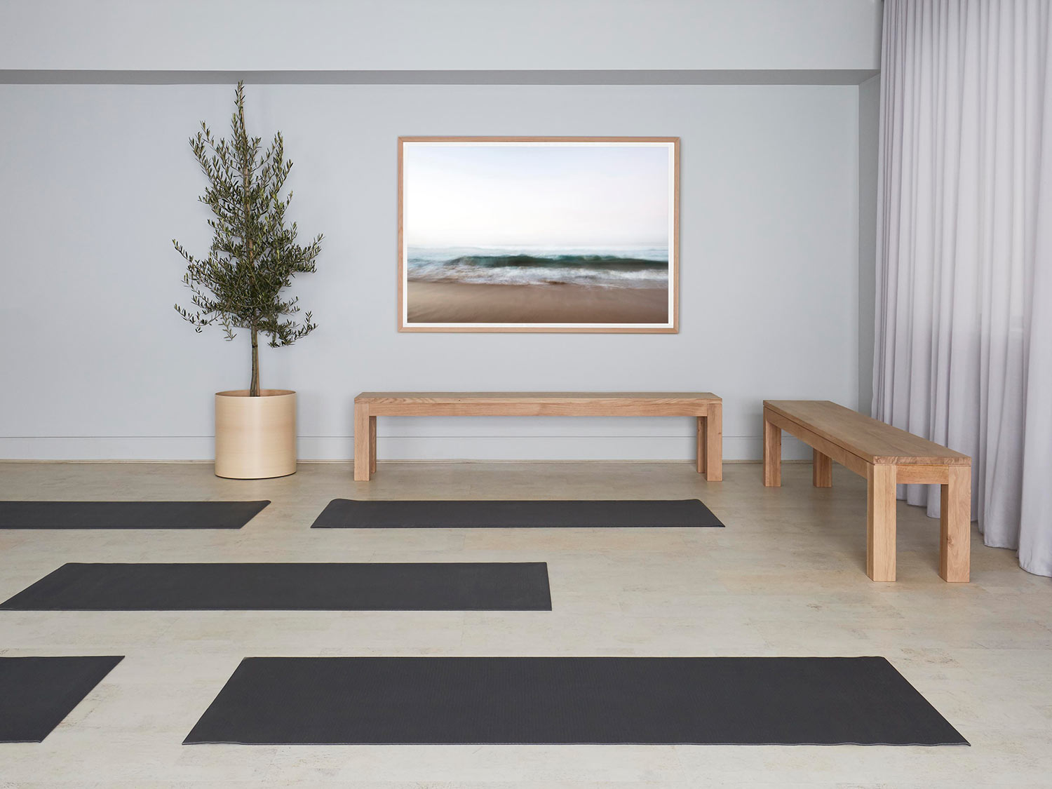 sparse room decorated with benches